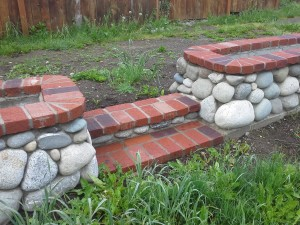 river rock planters with steps